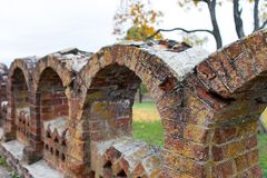 Ancient figured brick masonry. Fencing in the Rukavishnikov manor in the village of Podviazye, Bogorodsky District. stock images
