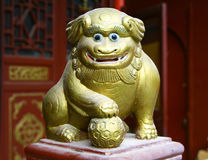 Ancient figurine of funny lion in chinese taoist temple. Ancient figurine of funny lion, decorative detail of chinese taoist temple Stock Photo