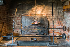 Ancient fireplace. Close-up of a medieval bricked fireplace Royalty Free Stock Photo