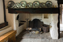 Ancient fireplace. Interior of a medieval rustic cottage Stock Images