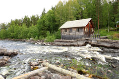 Ancient fishing camp view across running water Stock Image
