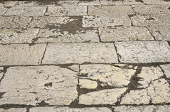 Ancient flagstones of the Roman paving Royalty Free Stock Images