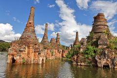 Ancient flooded pagodas Stock Photos