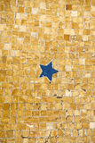 Ancient floor mosaic showing a blue five pointed star. Stock Image