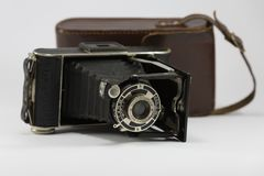 Ancient Folding Camera with Bellows and Brown Leather Case Stock Photo