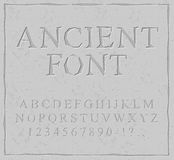 Ancient font. Carved on stone plate alphabet. Prehistoric alphab. Et. Antique set of letters Royalty Free Stock Photography