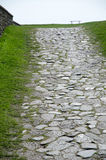 Ancient foot path. Leading upwards to a bench Royalty Free Stock Photography