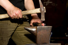 Ancient forging hammer and anvil Royalty Free Stock Images