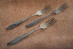 Ancient forks on a soft towel Royalty Free Stock Images