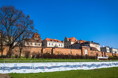 Ancient fortifications. Surrounding the Old Town in Torun, Poland, on March 30, 2014. The quotations and paintings on the wall in the foreground refer to the stock photo