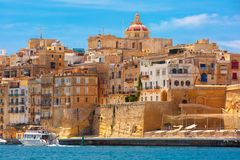 Ancient fortifications of Valletta, Malta. Quay of Valletta with traditional Maltese building with colorful shutters and balconies in the sunny day, Valletta Royalty Free Stock Photos