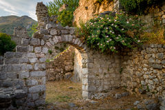 Ancient fortress arch way and ruined walls Royalty Free Stock Photography