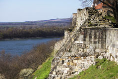 Ancient fortress a bit ruined stone wall. Hungary. Bit ruined fortification located on the top of the mountain above the Danube river. Part of the picture takes Royalty Free Stock Images