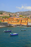 Ancient fortress, city beach and fishing boats. Funchal, Madeira, Portugal Stock Image