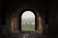 Ancient fortress gate - from darkness to light Royalty Free Stock Photography