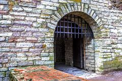 Ancient fortress gates and a metal lattice. Fortress `Oreshek`, Europe, Shlisselburg, 700 year old castle. Architectural design of stones and bricks, old Stock Photos
