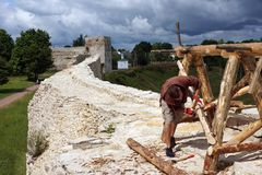 Ancient fortress. Man working on the wall of the fortress Royalty Free Stock Photography