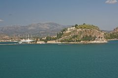 Ancient fortress of Nafplion, Greece. Arrival in Nafplion, Greece. View from the sea of the coast and the port Stock Images