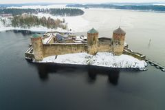 The ancient fortress of Savonlinna on the background of Saimaa lake aerial photography. Finland. The ancient fortress of Savonlinna on the background of Saimaa stock photos