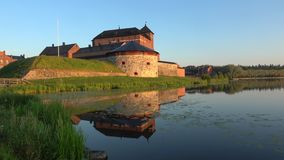 The ancient fortress on the shore of lake Vanajavesi. Hameenlinna, Finland stock video footage