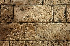 Ancient fortress wall detail. Ancient weathered fortress wall detail background texture Stock Photos