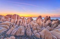 Ancient fossil rock plain dawn on coastline Royalty Free Stock Photos