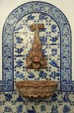 Ancient fountain with azulejo Stock Images