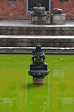 Ancient fountain in Bhaktapur. Nepal. Now destroyed after a mass Royalty Free Stock Image
