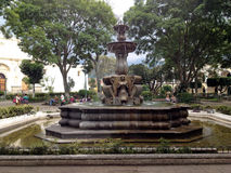 Ancient fountain in the central square of Antigua Royalty Free Stock Photo