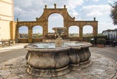 Ancient fountain on the historic center of Pitigliano Stock Image