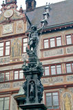 Ancient fountain Neptune on a background the facade of town hall Stock Photos