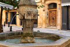 Ancient fountain in Provence. Ancient founatin from the old part of Aix en Provence town, PACA, France, typical provence architecture Stock Images