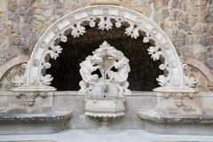The ancient fountain in the Quinta da Regaleira in Sintra Stock Photo