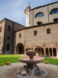 Ancient fountain in red marble and in the background the cloiste. R of the abbey of Carceri, Padua, Italy Royalty Free Stock Photos