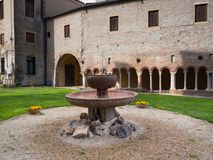 Ancient fountain in red marble and in the background the cloiste. R of the abbey of Carceri, Padua, Italy Stock Photography