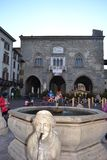Ancient fountain and to a street show of famous movie characters. stock photos