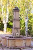 Ancient Fountain in a Village Traditional Symbol. Trees Font Vintage royalty free stock image