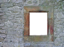 Ancient frame. An isolated window frame on an ancient wall. Useful for photomontage stock photos