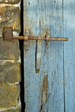 Ancient French lock. An old French lock secures a rustic outbuilding door stock photography