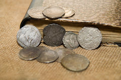 Ancient French silver coins with portraits of kings on the old c Royalty Free Stock Images