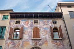 An ancient fresco on the wall of the house. Conegliano. Italy. An ancient fresco on the facade of the house. Conegliano. Italy Royalty Free Stock Photos