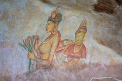 Ancient fresco with the image of imperial concubines on a wall of the mountain palace Sigiriya Royalty Free Stock Photography