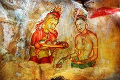 Ancient fresco on mount Sigiriya, Sri Lanka. Ancient fresco depicting two maiden with fruits on the ancient rock fortress Sigiriya, Sri Lanka. Sigiriya ( Lion's Royalty Free Stock Photography