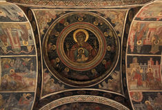 Ancient Fresco of Stavropoleos Monastery. Ancient mural painting of Saint Mary Mother and Jesus Christ, Apostles on the ceiling in Stavropoleos Monastery in Stock Photography