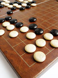 Ancient game of Weiqi or Go. Cornered! - A corner of an traditional ancient chinese chess game board. Game is called Weiqi, or Go. Layout of black and white Stock Image