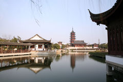 Ancient garden. Chinese traditional garden with lake, Pagoda, pavilion, long gallery, etc Royalty Free Stock Photography