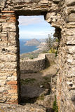 Ancient gate. Beautiful Mediterranean view through ancient stone gate, Erice town, Sicily, Italy Stock Image