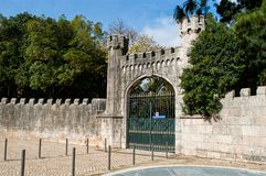 Ancient gate with an arched door into a garden Royalty Free Stock Photos