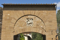 Ancient gate with a bas-relief of rider in Florence Stock Images