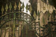 An ancient gate. Detail of an old wrought iron gate, a symbol of a bygone era and perfect craftsmanship of an earlier era Royalty Free Stock Photo